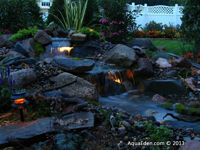 evening-waterfall-lights-backyard-mn